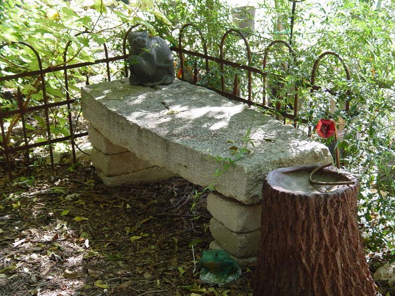 D. Stone bench