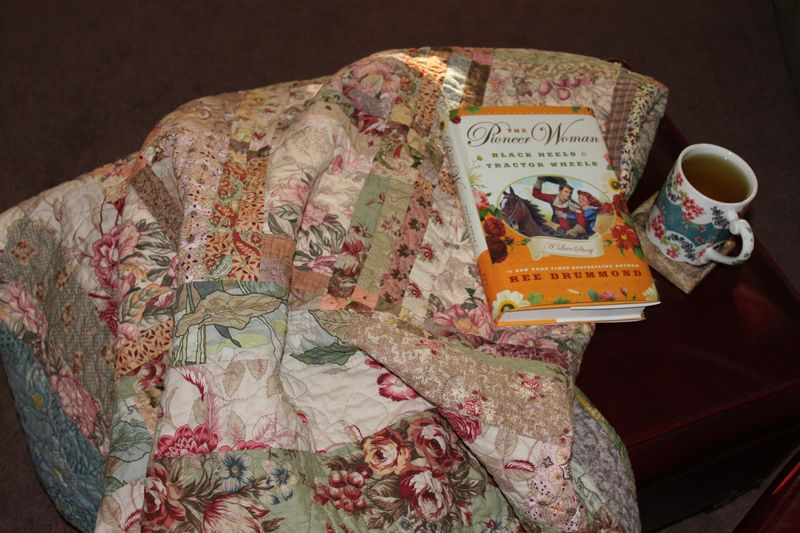 Quilt, book, tea